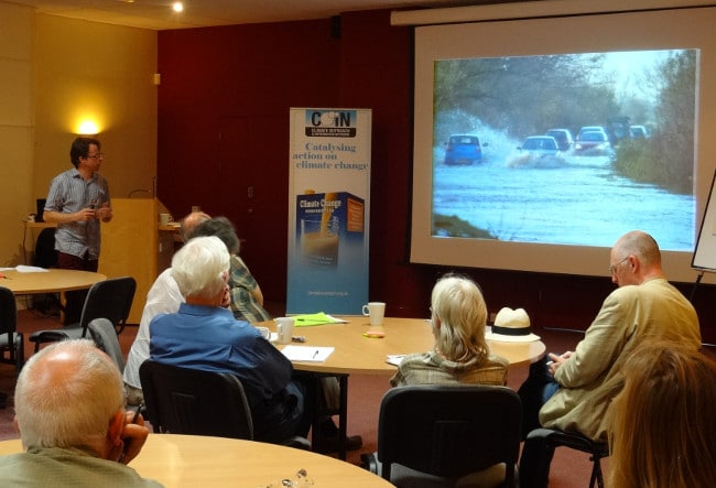 Participants watch footage of other flooded communities.