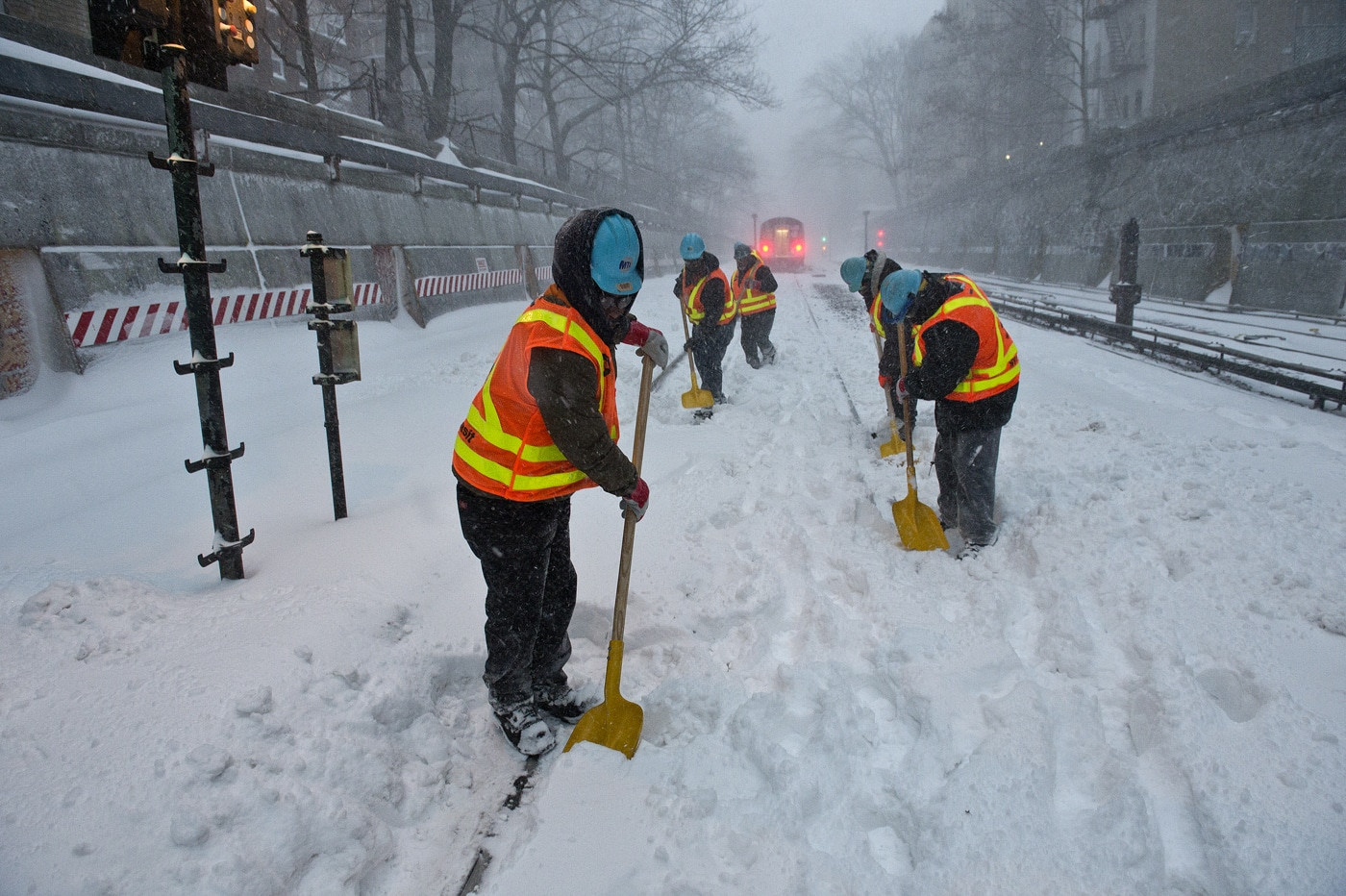 MTA New York City Transit battled the blizzard as crews cleared snow along the Q line in Brooklyn on Saturday, January 23, 2016.